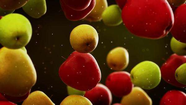 Slow motion CG animation of apples with water droplets falling down in front of blurry background Royalty-free stock video