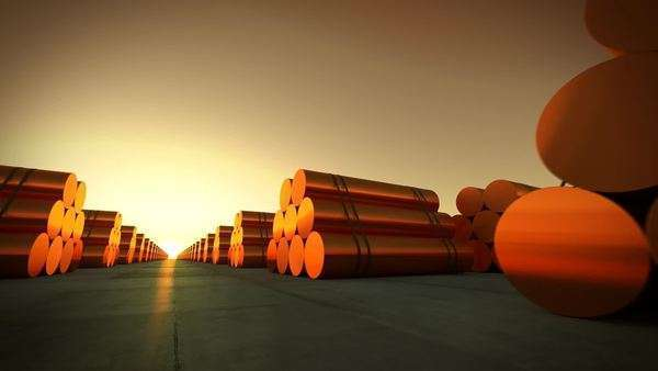 Loopable animation presents rows of cylindrical copper billets in front of setting sun Royalty-free stock video
