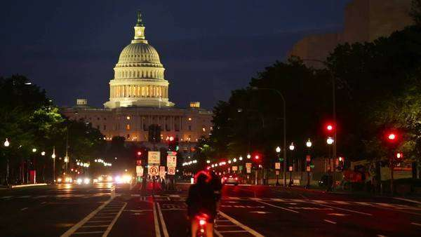 Washington DC, United States Capitol building night view from  Pennsylvania Avenue with car lights Royalty-free stock video