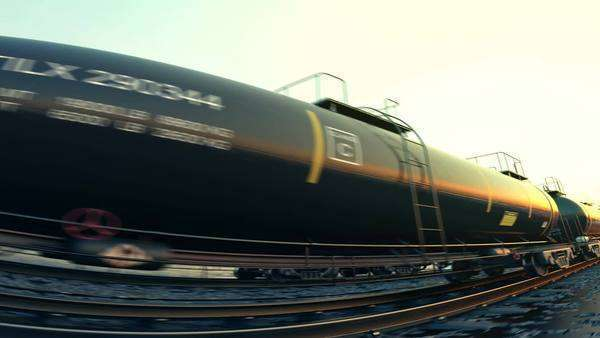Loopable animation of a tank wagons during sunset. Setting sun reflected on the wagon surface. Royalty-free stock video