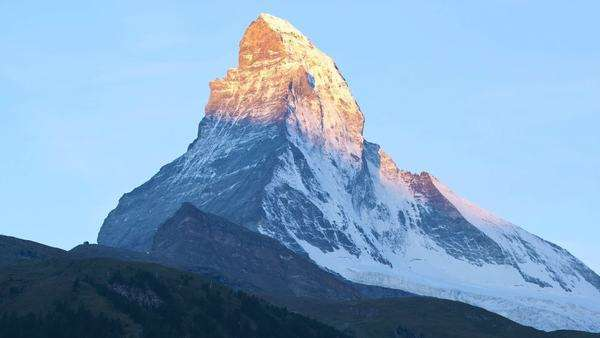 Dawn view in motion timelapse sun rising down Matterhorn Peak, Zermatt, Switzerland, Europe Royalty-free stock video