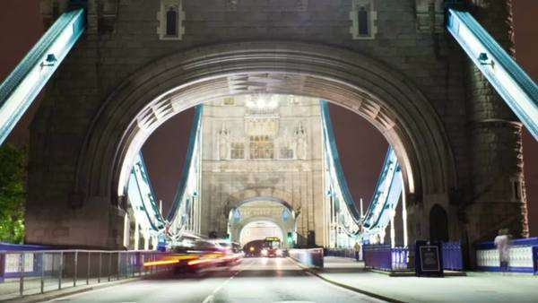 Timelapse shot in the evening of the front of the Tower Bridge in London, England. Filmed in October 2011. Panning shot. Royalty-free stock video