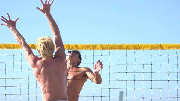 Men playing beach volleyball, super slow motion Royalty-free stock video