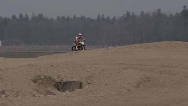 Motocross biker racing across the polygon, wide shot Royalty-free stock video