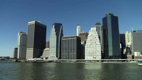 New York City financial district in the autumn seen from the east with tour boats in the foreground Royalty-free stock video