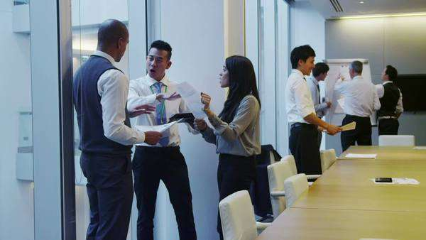 Diverse business team working together in meeting room of modern office Royalty-free stock video