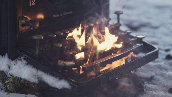 Close up of Bakelite typewriter burning on snowy ground Royalty-free stock video