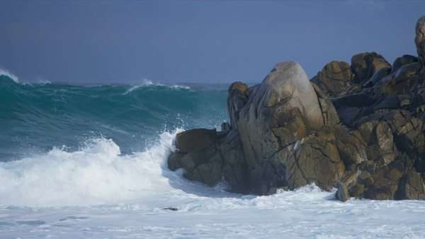 Powerful tidal waves crashing onto jagged rocks coastal waters shot on RED EPIC. Royalty-free stock video