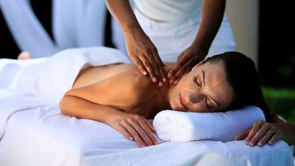 Sophisticated lady relaxing with massage treatment at a luxury health & beauty spa. Royalty-free stock video