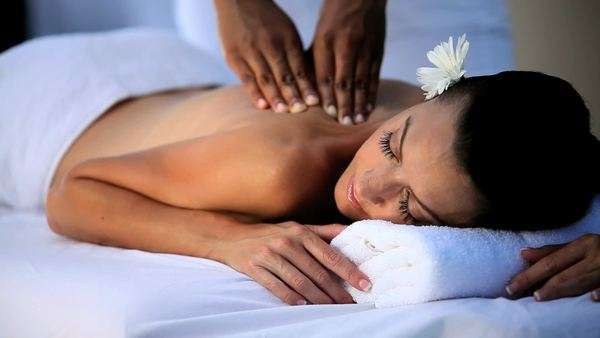 Beautiful lady being pampered with massage treatment at a luxury health & beauty spa. Royalty-free stock video