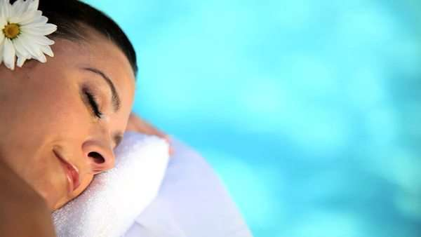 Beautiful lady relaxing with LaStone massage treatment at the health & beauty spa. Royalty-free stock video
