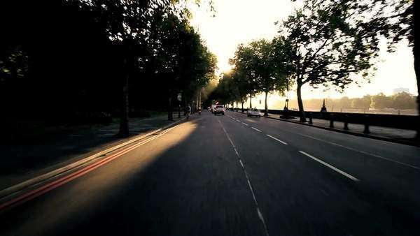 Point-of view driving through quiet city streets in early morning. Royalty-free stock video