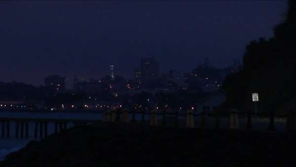Cars head towards the Golden Gate Bridge and the temptations of San Francisco at night. Royalty-free stock video