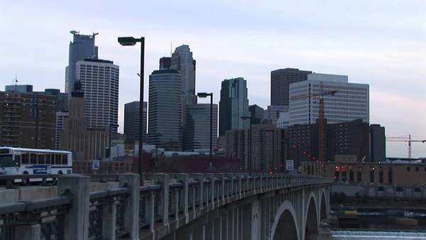 Traffic moves across a bridge into the city in this clip. Royalty-free stock video