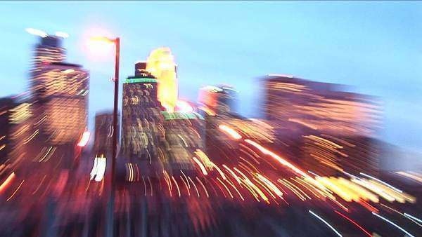 Swish-pan creating trace lights of Minneapolis Minnesota skyline at twilight. Royalty-free stock video