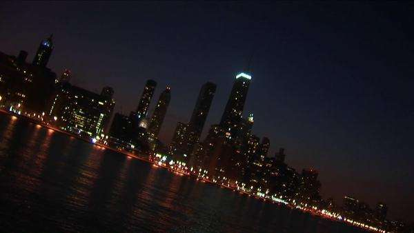 A sweeping angled view of Chicago at night from the lakefront. Royalty-free stock video