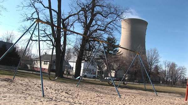 An otherwise typical residential neighborhood has been joined by a nuclear power plant. Royalty-free stock video