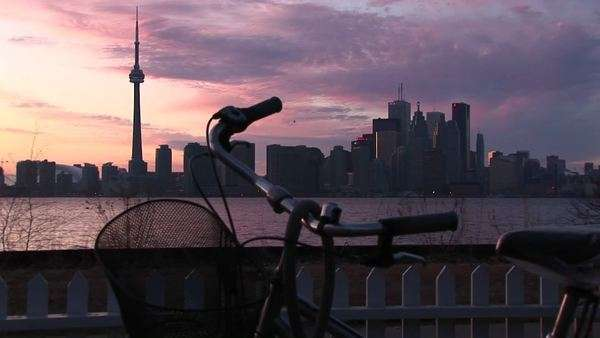 A bicycle sits in a yard across the lake from the Toronto skyline. Royalty-free stock video