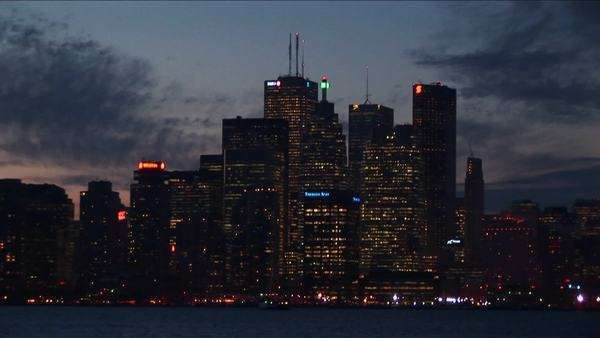 Lights illuminate skyscrapers along Lake Ontario. Royalty-free stock video