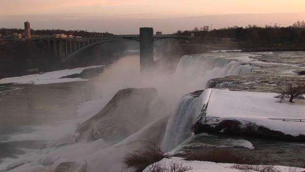 Niagara Falls in winter from the top looking toward the closest bridge. Royalty-free stock video