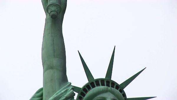 The Statue of Liberty holds her torch up to the sky. Royalty-free stock video