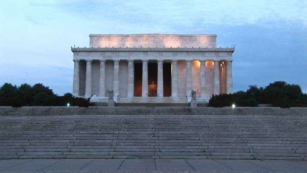 A distance shot of the Lincoln Memorial during golden-hour. Royalty-free stock video