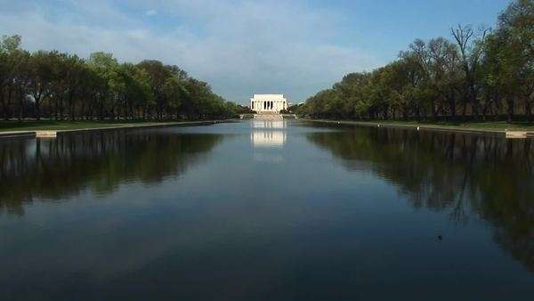 Long-shot of reflecting pool and Lincoln Memorial on the National Mall in Washington, D.C. Royalty-free stock video