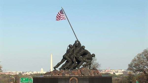 The Iwo Jima Marine Corps Memorial stands tall with the Washington Monument faintly in the background. Royalty-free stock video