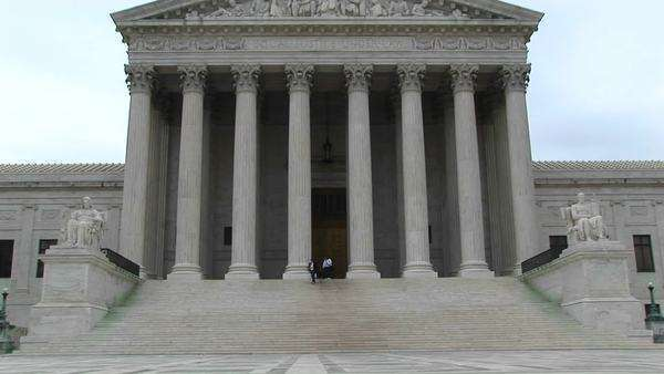 A pan-up of the columned entrance to  the Supreme Court. Royalty-free stock video