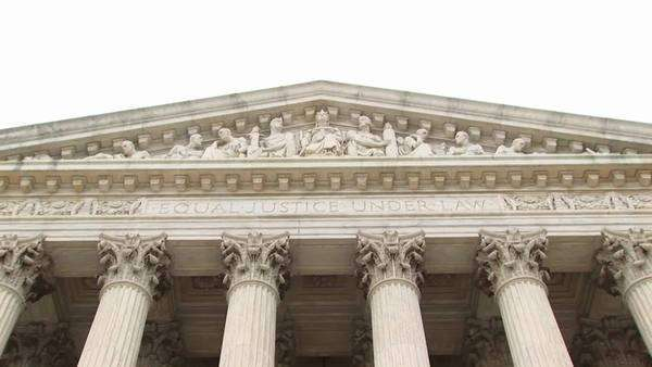 Close view of the entrance pediment sculpture on the Supreme Court Building. Royalty-free stock video