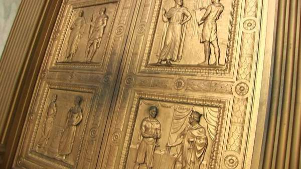 Close view pan-up of the bronze sculptures on the west entrance doors of the Supreme Court. Royalty-free stock video