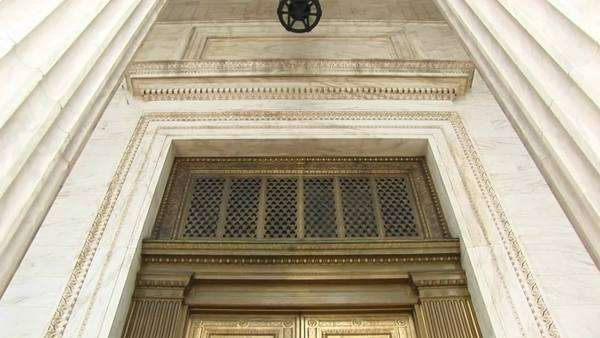 View of columns and lamp above bronze doors at the west entrance of the Supreme Court. Royalty-free stock video