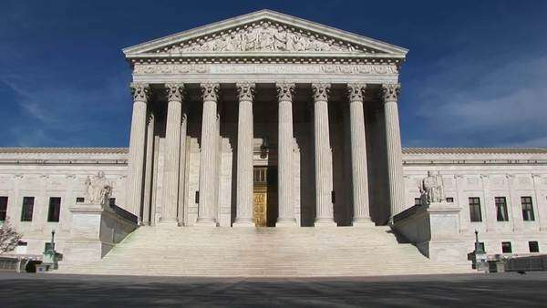 A pan-right along the U.S. Supreme Court Building and grounds. Royalty-free stock video