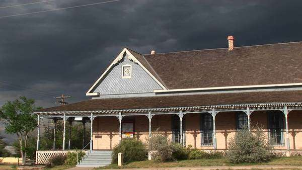 Medium-shot of a ranch house with storm clouds building behind. Royalty-free stock video