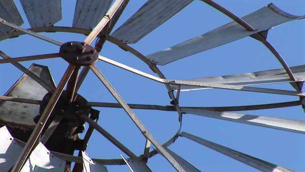 Close-up of the blades of a windmill spinning. Royalty-free stock video
