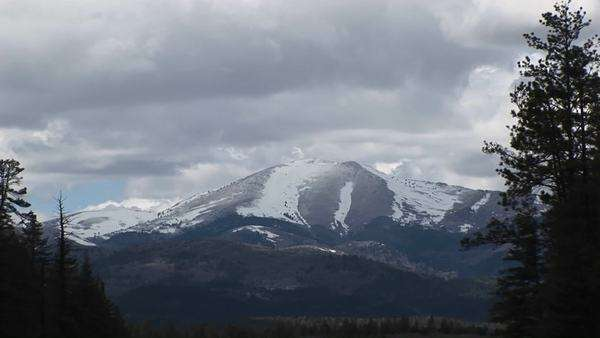 Zoom-in on a snowy mountain peak in the Sierra Blanca Mountain Range in New Mexico. Royalty-free stock video