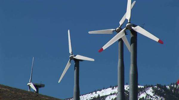 Medium-shot of four wind turbines generating power at Tehachapi, California. Royalty-free stock video
