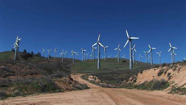 Long-shot of numerous wind turbines generating power at Tehachapi, California. Royalty-free stock video