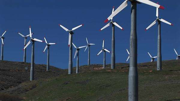 Medium-shot of several wind turbines generating power at Tehachapi, California. Royalty-free stock video