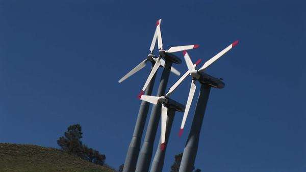 Tilt-shot of four wind turbines generating power at Tehachapi, California. Royalty-free stock video