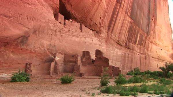 Long shot of cliff dwellings in Canyon De Chelly National Monument. Royalty-free stock video