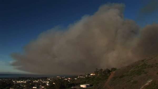 Long shot of a cloud of wildfire smoke hovering over Ventura, California. Royalty-free stock video