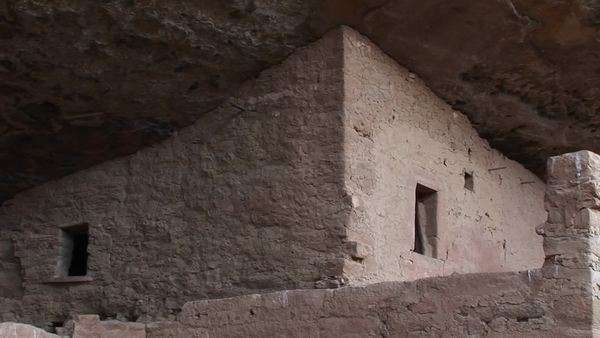 Medium shot of the ruins of Native American cliff dwellings in Mesa Verde National Park, Colorado. Royalty-free stock video