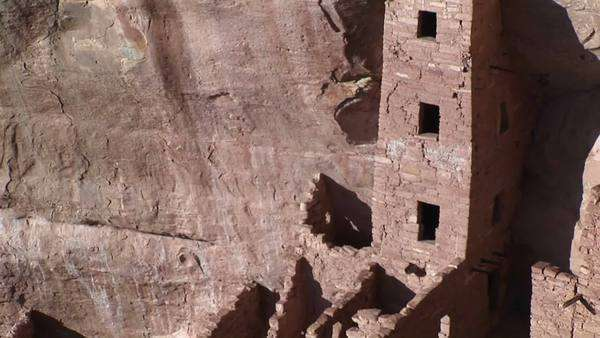 Pan-up of the ruins of Native American cliff dwellings in Mesa Verde National Park. Royalty-free stock video