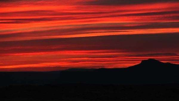 Medium-shot of a brilliant orange sunset over Lake Powell, Arizona Royalty-free stock video