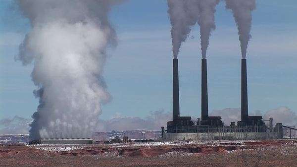 Medium-shot of a factory releasing pollution in the Arizona Desert. Royalty-free stock video