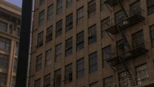 Zoom-in on the windows of a multi-story building. Royalty-free stock video