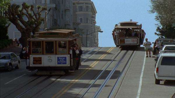 Two San Francisco cable cars pass each other. Royalty-free stock video
