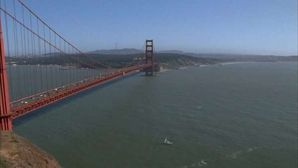 Pan left reveals the Golden Gate Bridge with traffic. Royalty-free stock video
