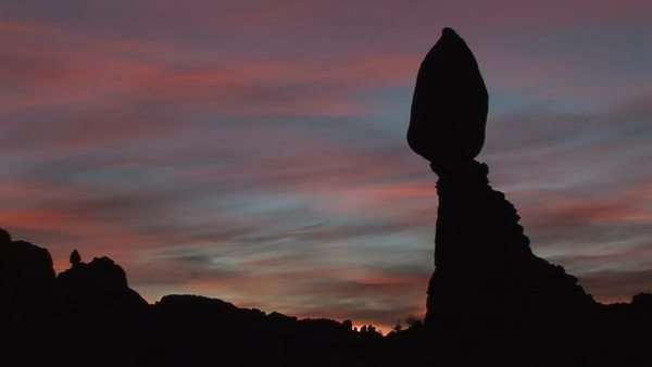 Balanced Rock is silhouetted against a brilliant sky in Arches National Park, Utah. Royalty-free stock video